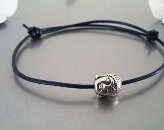 Navy blue leather adjustable bracelet with a Buddha head bead