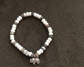 White turquoise and agate beaded bracelet with hill tribe elephant charm