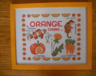 Frame orange counted stitches with the theme color ORANGE