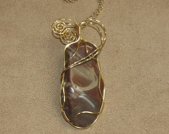 031 Two-eyed brown hour glass stone twisted wire
