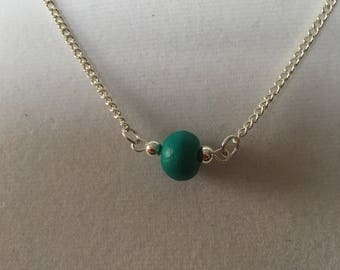 """Turquoise wooden bead on a sterling silver 18"""" chain.  Minimalist necklace."""