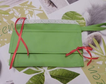 A flat make-up case in Apple green leatherette