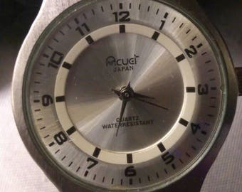 Acuet Japan ladies quartz watch in like new condition. Stainless steel mesh adjustable band.  Water resistant. Very attractive brushed case