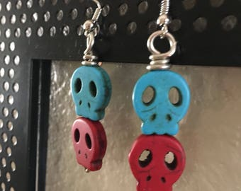Red and teal skull earrings