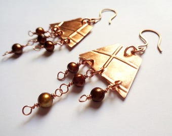 Copper earrings made entirely by hand and river Pearls