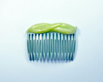 Green comb with soft silicone decoration