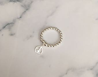 Sterling Silver stretch ring with Peace Sign charm