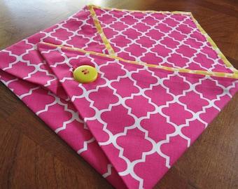 Medium pink and yellow patterned dog bandana with trim