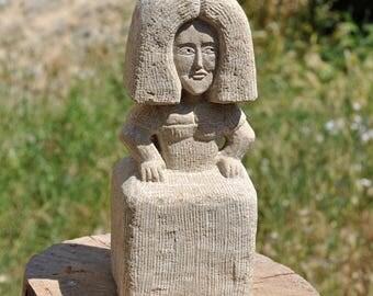 Menina in stone sculpture
