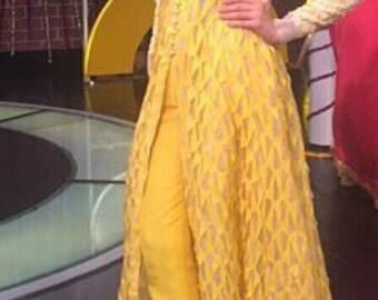 Nida Azwer Yellow laser cut gown