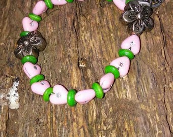 Green and pink heart beaded bracelet.