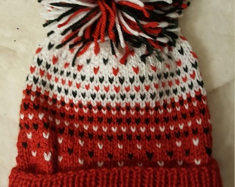 Red, black and white pompom hat