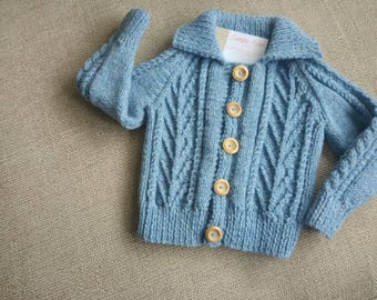 Toddlers hand knitted aran jacket with colar in denim blue