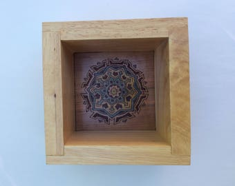 Laser-cut/laser-engraved abstract design on cherry veneer wood in a shelf box