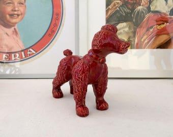 Red ceramic poodle.