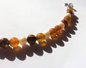 Yellow and brown crackled agate with pearl bead bracelet