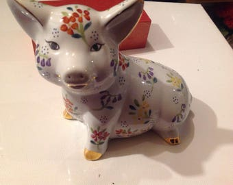 Vintage porcelain pig with flowers