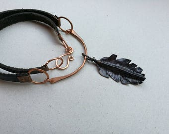 Leather necklace with copper feather pendant