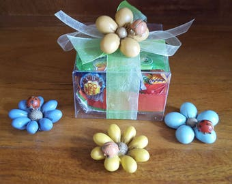 Clear paarty box with mixed sweets and flower magnets.
