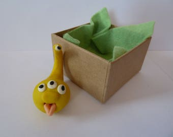 Polymer clay, fun yellow Monster in a box.