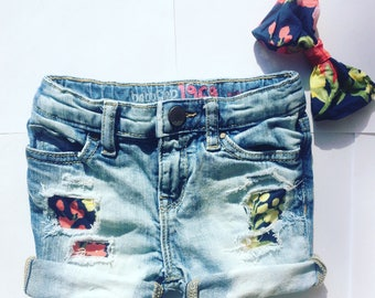 Floral patched distressed denim shorts