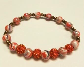Orange swirl bead bracelet, stretchy