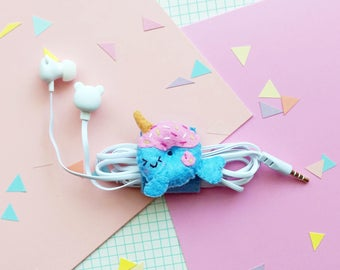 Narwhal unicorn earphone organizer with headphones, iphone earbuds, samsung earpods, phone accessories