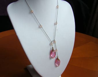 Lovely Art Deco necklace with 2 pink cut glass pendant droppers and 9 pink faceted spacer beads.