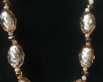 Silver peach color beaded necklace and earrings