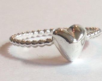 Handmade fine silver heart ring.