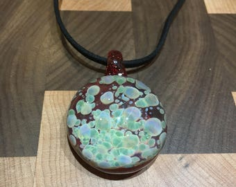 Glass pendant with suede rope