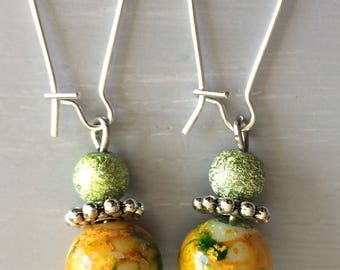 Yellow and green metal and glass earrings