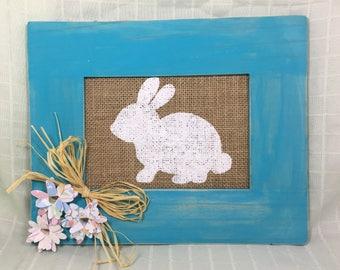 Caribbean wash wood frame with  bunny on burlap.