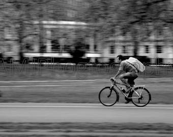 bicycle rider black & white city view digital file photographed by Avi Abramovitz