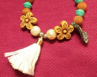 Fairytale wooden beaded tassle bracelet