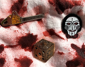 Horror Enamel Pin Set | 3 Horror Pins | The Texas Chainsaw Massacre | Jigsaw Puppet Billy Doll | Hellraiser Puzzle Box Lament Configuration