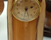 A Brass Clock set in a Beautiful  Sliced Branch of Yew