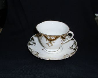 Vintage small cup and saucer, white and 24K gold