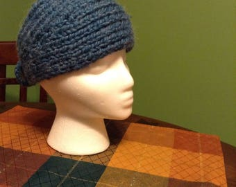 handknit wide earwarmer with flower or button.