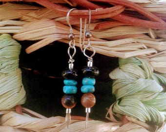 Handmade black onyx, turquoise, and tiger eye earrings, with silver findings.