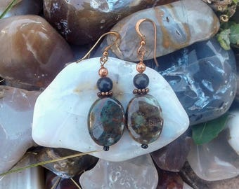 Handmade lava and serpentine earrings.