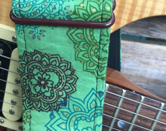 Guitar strap with lacy design in green, blue and cordovan