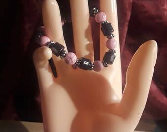 Pink and black with silver spacers/handcrafted/stretch cord