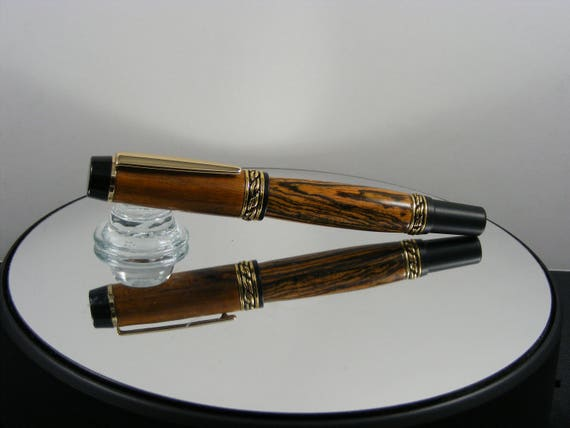 Handcrafted Olympian Rollerball Ink Pen in 24K Gold and Black Enamel with Bocote Wood