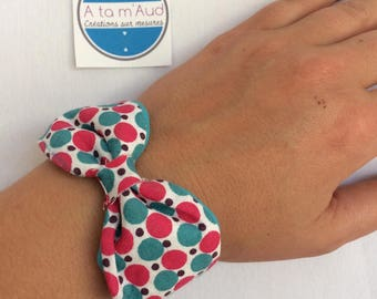 Bracelet turquoise blue reversible bow and polka dots.