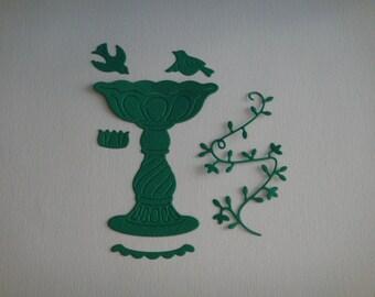 Cut paper green bird feeder