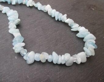 Aquamarine - Chips 5-12mm pale blue seed beads * 10-85 cm long 1 strand