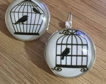 "Earrings ""like a bird in cage..."""