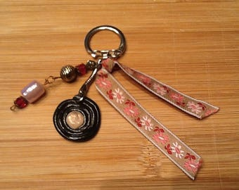 Roll of licorice and Pearl keychain