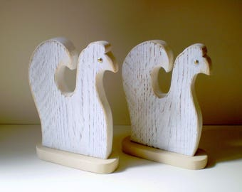 Two hens in solid wood cut and patinated by hand on stand